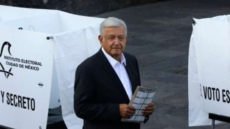 Presidential candidate Andres Manuel Lopez Obrador holds his ballot while voting at a polling station during the presidential election in Mexico City, Mexico, July 1, 2018. REUTERS/Carlos Jasso